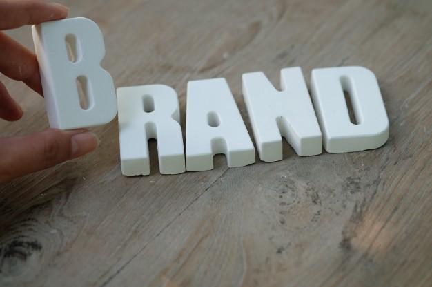 hand-arrange-white-letters-brand_1384-198